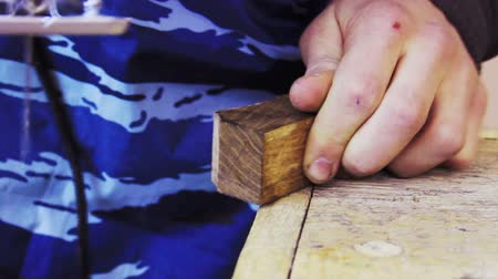 jigsaw : Woodworking. Mans hands cut off a piece of wood electric jigsaw