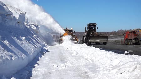 snow plow : Machine cleans the snow on the track .240 FPS slow motion Stock Footage