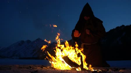 dissenter : a mad monk meditation next to the campfire Stock Footage