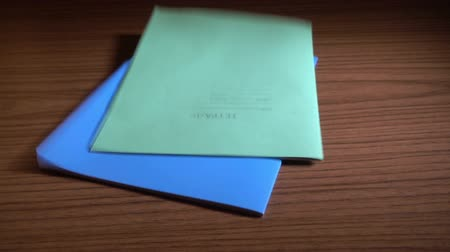 espaço de texto : Two notebooks falling on the table. Slowmotion 240 FPS Stock Footage