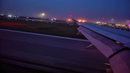 futópálya : Wing of airplane taking off, night view on the runway