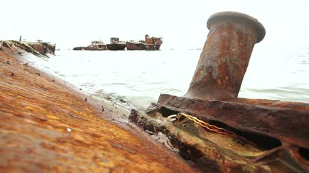 veszélyes : Graveyard of ships on the port of Sakhalin Island Stock mozgókép