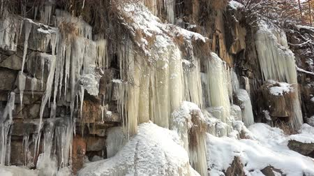 сосулька : frozen waterfall on a rock