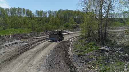 buldozer : bulldozer moves on the country road