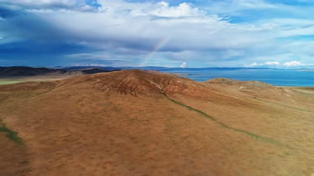 インナー : Mongolia, Lake Telmen-Nuur surrounded by desert mountains. Aerial shot of the rainbow between the clouds