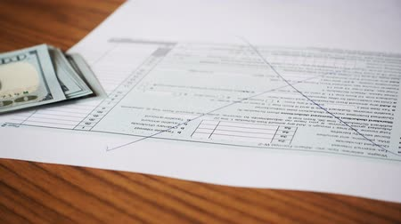 bürokrasi : Crumpled sheet of tax form on the table. Close up. Stok Video