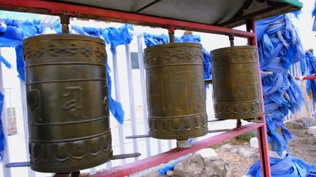 moğolistan : People spins some Buddhist prayer drums. Western Mongolia.