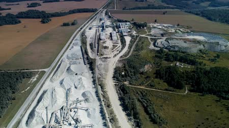 Aerial view of crusher works with rubble at extraction site. Rock stone crushing machine at a mining quarry.