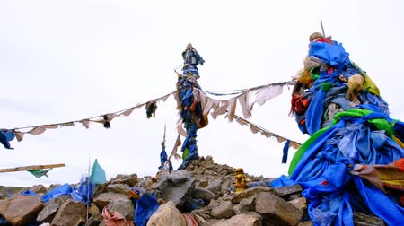 prayer flag : Obo a place of worship for local spirits in West Mongolia Stock Footage