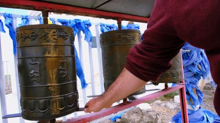 mantra : People spins some Buddhist prayer drums. Western Mongolia.