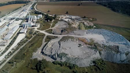 lom : A large pile of unused rock, industrial storage of loose materials. Aerial view.