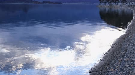 The evening cloudy sky is reflected in the Tolbo Nuur Lake Wideo