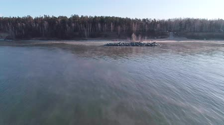 Sea sunrise and foggy morning. Fog above blue ripple water, aerial view. Stok Video