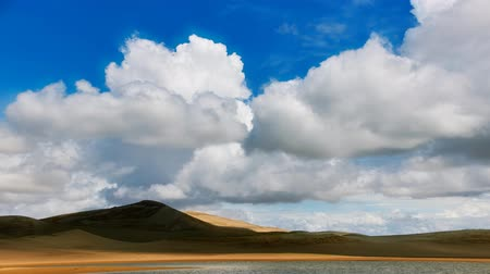 Clouds moving over Barkhans in Mongolia sandy dune desert Mongol Els. Khovd province, Western Mongolia.
