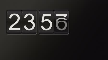 counter : Classic flip clock watch counting hours and minutes from 00:00 to 23:59 with white numbers on black background; time lapse animation with natural sound, loop possible, copy space Stock Footage