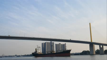 bridge man made structure : Time lapse of suspension bridge, sky, traffic and ship Stock Footage