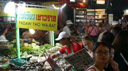 yaowarat road : Bangkok, Thailand-November 3, 2018: People dining and bustling around China town of Bangkok. Yaowarat Road (China Town) is famous for street food with lively environment.