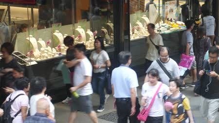 Hong Kong, Hong Kong S.A.R-June 3, 2017: Jewelry shop in Hong Kong. Pedestrians on the sidewalk in Hong Kong