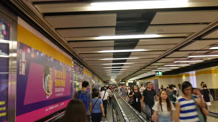 Hong Kong, Hong Kong S.A.R.-June 3, 2017: View of Moving walkway in subway station in Hong Kong. Commuters are inside the subway station. Vídeos