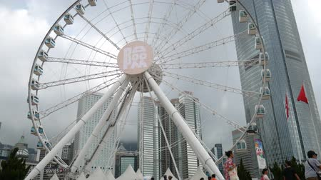 cbd : Hong Kong, Hong Kong S.A.R.-June 3, 2017: Ferris wheel in Hong Kong and skyscrapers in Hong Kong.