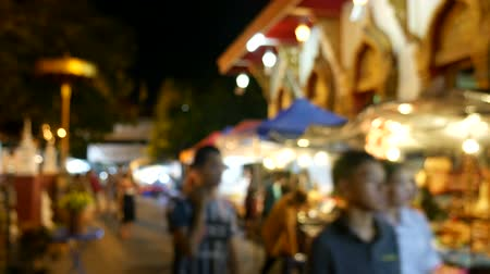 flea : Tourists and locals walk among stalls at the famous Sunday walking street (Thapae walking street), Chiang Mai, Thailand.