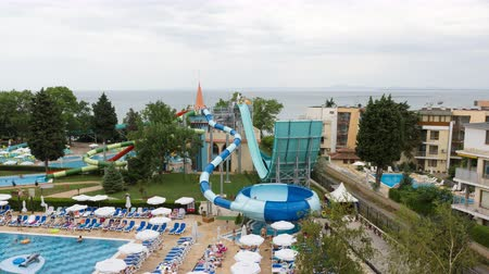 small park : Nessebar, Bulgaria - JUNE 23, 2016: Hotel Sol Nessebar adults and young hotel guests have fun at the water park.