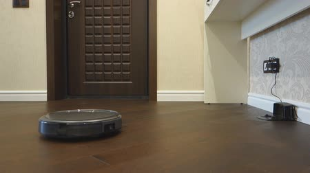 esparso : Robotic vacuum cleaner rides on the floor and turns