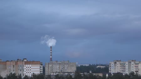 distillation : Smoke comes from the factory pipe above the city