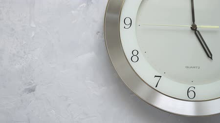 numerais : one minute before five on the wall clock