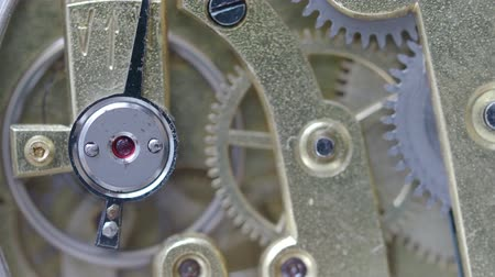 pinion : macro shot - movement of running retro brass mechanical watch with focus on ruby ??stone on foreground