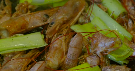 pırasa : frying langoustine shells with leek and spices for cooking shrimp broth close up Stok Video