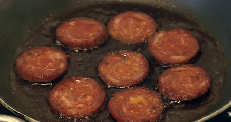 seethe : frying slices of chorizo ??sausage in oil on pan Stock Footage