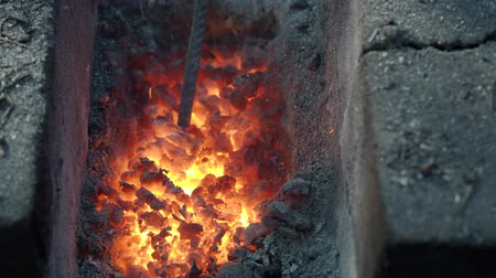 firebox : hot coals in a forge in a rural rural smithy outdoors