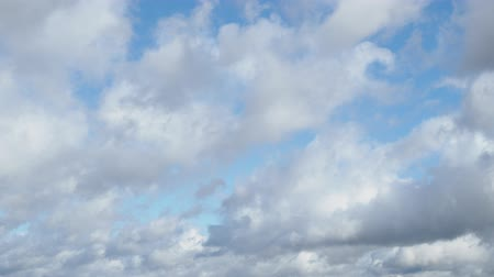 bulutluluk : gray and white clouds quickly run across blue autumn afternoon sky Stok Video