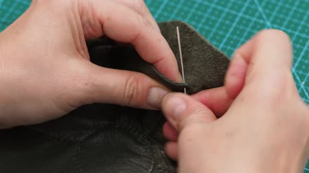 fixing the stitches of a pouch