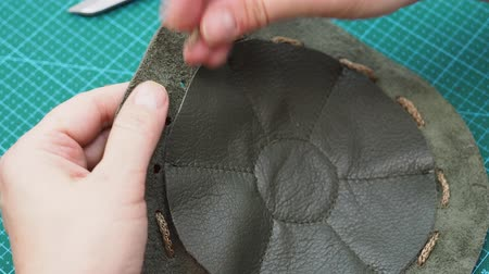 workshop for making leather bag for jewelry - craftsman in the sewn pouch Стоковые видеозаписи