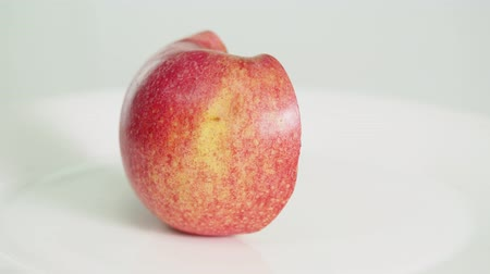 red apple on white background, part 1 Стоковые видеозаписи