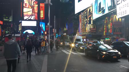 limuzína : NEW YORK CITY, USA - OCT 2: Times Square Time lapse, featured with Taxi Cabs, Shops and animated LED signs, is a symbol of New York City and the United States, October 2, 2016