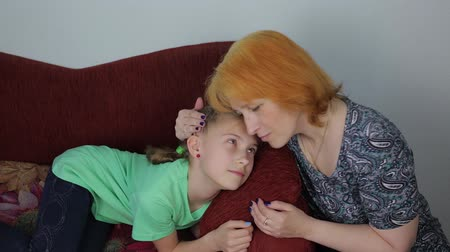 disobedient : Mom comforts her daughter Stock Footage