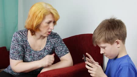 disobedient : Mom scolds his son for a long time with a gadget