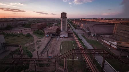 greenpeace : Time lapse. Factory at sunset. Tower. Blue sky. Moving clouds. Stock Footage