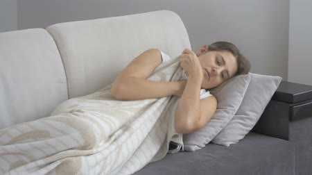 cover : Young depressed woman lying on sofa at living room Stock Footage