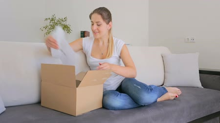 sipariş : Happy beautiful woman taking dress she order online out of the box
