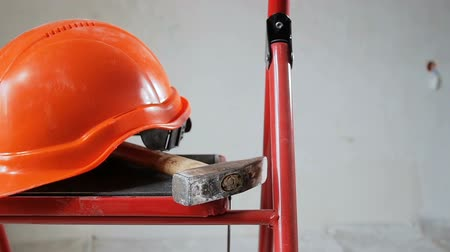 ayarlanabilir : Footage of working tools and red helmet at apartment under renovation. Concept of building