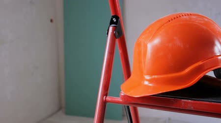 kötelesség : Footage of working tools and red helmet at apartment under renovation. Concept of construction