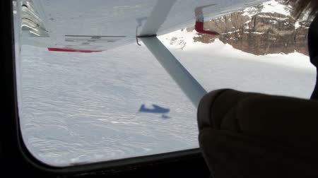 alaszka : View from inside of cockpit of airplane shadow taking off snowy runway
