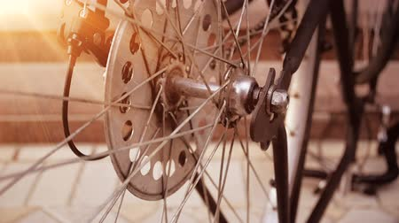 bisiklete binme : Slow motion video of vinatge bicycle wheel slowly rotating in sunset rays Stok Video
