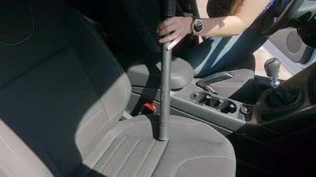 zametání : Slow motion video of female driver cleanming salon of her car with vacuum cleaner
