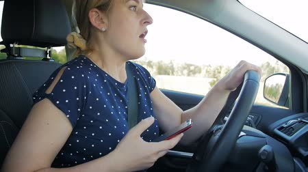 irresponsible : Slow motion footage of young woman got in car accident while driving and typing message on cell phone