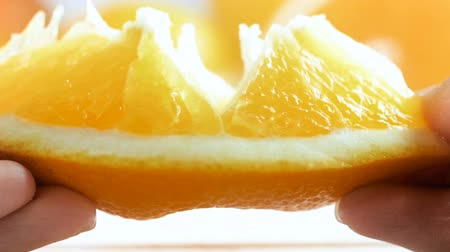 segmento : Closeup slow motion video of juice bursting from orange slice Stock Footage
